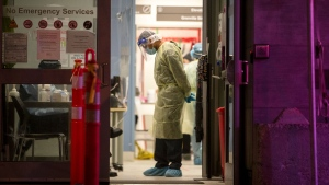 A healthcare worker pauses during a lull in visitors at a COVID-19 testing centre in Toronto, Sunday, Dec. 20, 2020. THE CANADIAN PRESS/Chris Young