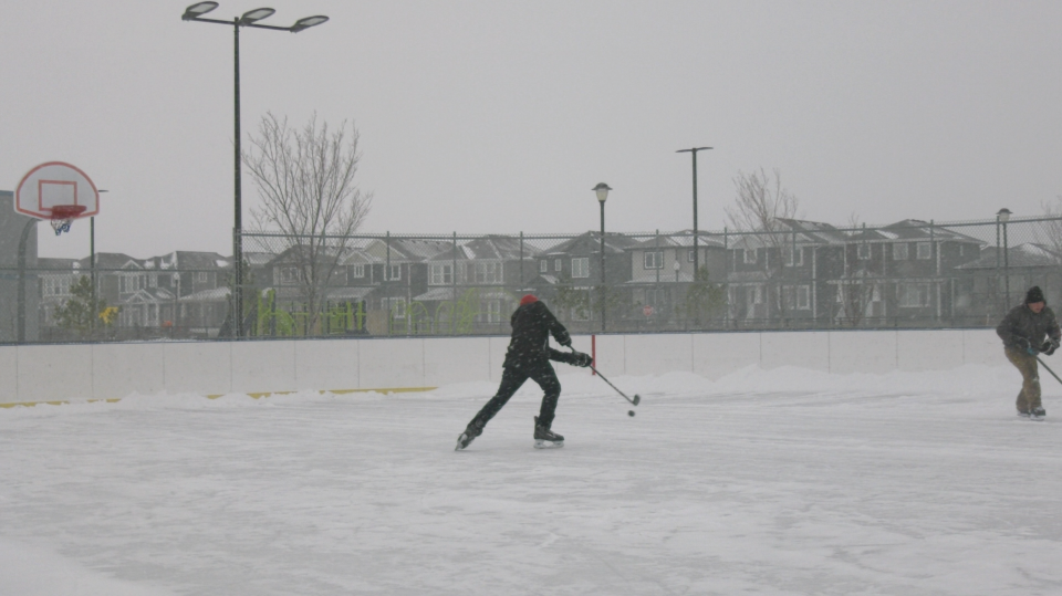 A resident is seen playing hockey on a Regina outdoor rink. (Claire Hanna / CTV News Regina)