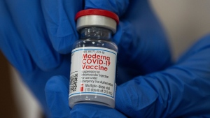 Michelle Chester, director of employee health services at Northwell Health, holds a bottle containing the Moderna COVID-19 vaccine at Northwell Health's Long Island Jewish Valley Stream hospital in Valley Stream, N.Y., on Monday, Dec. 21, 2020. (Eduardo Munoz/Pool via AP)