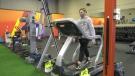 Shara Vigeant walking on the treadmill in her gym. Dec. 23, 2020. (CTV News Edmonton)