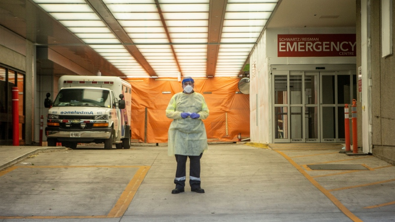 A paramedic stands in the ambulance bay of Mount Sinai Hospital in Toronto, on Saturday, June 6, 2020. THE CANADIAN PRESS/Chris Young