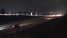 Traffic is directed off Highway 401 amid multiple crashes near Dorchester, Ont. on Thursday, Dec. 24, 2020. (Jim Knight / CTV News)