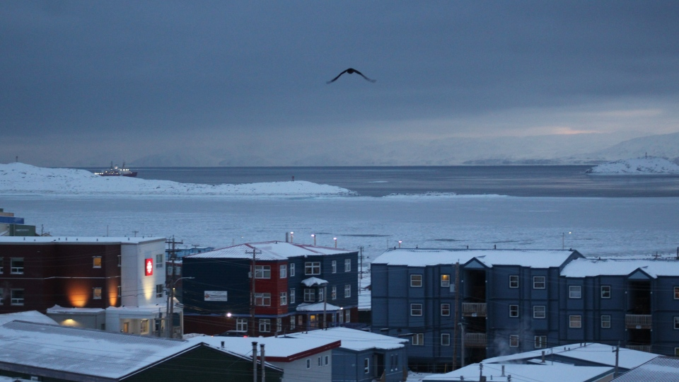 Downtown Iqaluit, Nunavut, is shown after 2 p.m. sunset on Tuesday, Nov. 24, 2020. (THE CANADIAN PRESS/Emma Tranter)