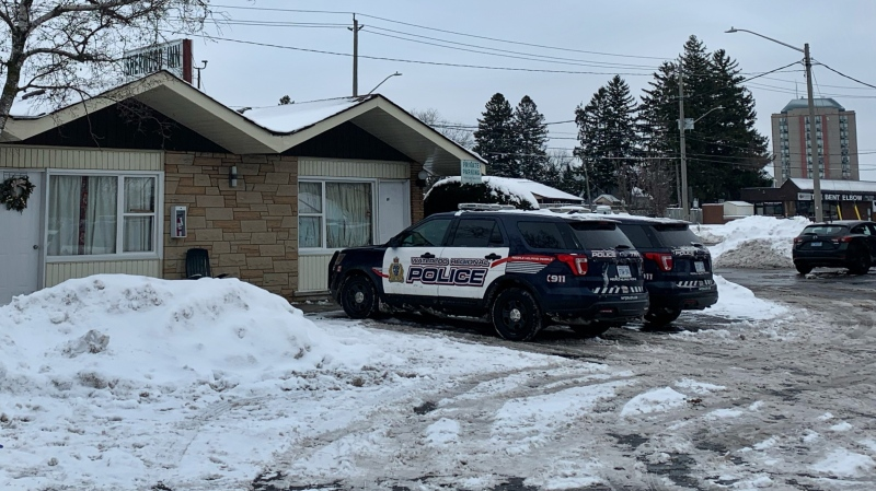 Waterloo regional police on scene on Weber Street East in Kitchener investigating after a dead woman was found. (Carmen Wong - CTV Kitchener) (Dec. 27, 2020)