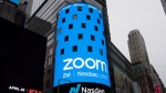 This April 18, 2019, file photo shows a sign for Zoom Video Communications ahead of the company's Nasdaq IPO in New York. (AP Photo/Mark Lennihan, File)