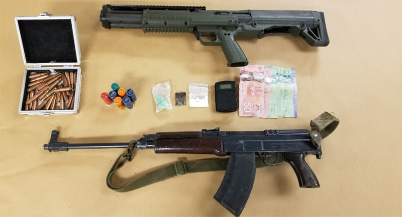 Firearms, ammunition, drugs and cash were seized in London, Ont. on Sunday, Dec. 27, 2020. (Source: London Police Service)