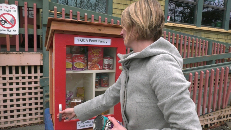 Caitlin Boudreau restocks the Community Food Pantry: Dec. 29, 2020 (CTV News)