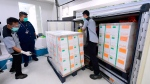 In this Dec. 7, 2020, file photo, released by Indonesian Presidential Palace, workers spray disinfectant on boxes containing experimental coronavirus vaccines made by Chinese company Sinovac arriving at a facility of state-owned pharmaceutical company Bio Farma, in Bandung, West Java, Indonesia. (Indonesian Presidential Palace via AP, File)