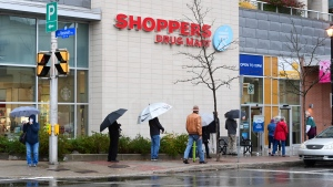 People line up to get an annual flu shot at a pharmacy in Ottawa on Thursday, Oct. 15, 2020. THE CANADIAN PRESS/Sean Kilpatrick