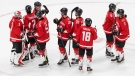 Canada celebrates the team's win after IIHF World Junior Hockey Championship action against Finland, in Edmonton, Thursday, Dec. 31, 2020. THE CANADIAN PRESS/Jason Franson