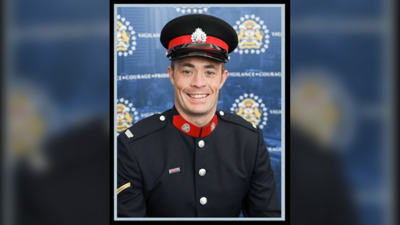 Sgt. Andrew Harnett, 37, of the Calgary Police Service is shown in this undated handout image provided by the police service. The service says Harnett, a 12-year veteran of the force, died on Thursday night after being hit by a driver allegedly fleeing a traffic stop. THE CANADIAN PRESS/HO-Calgary Police Service