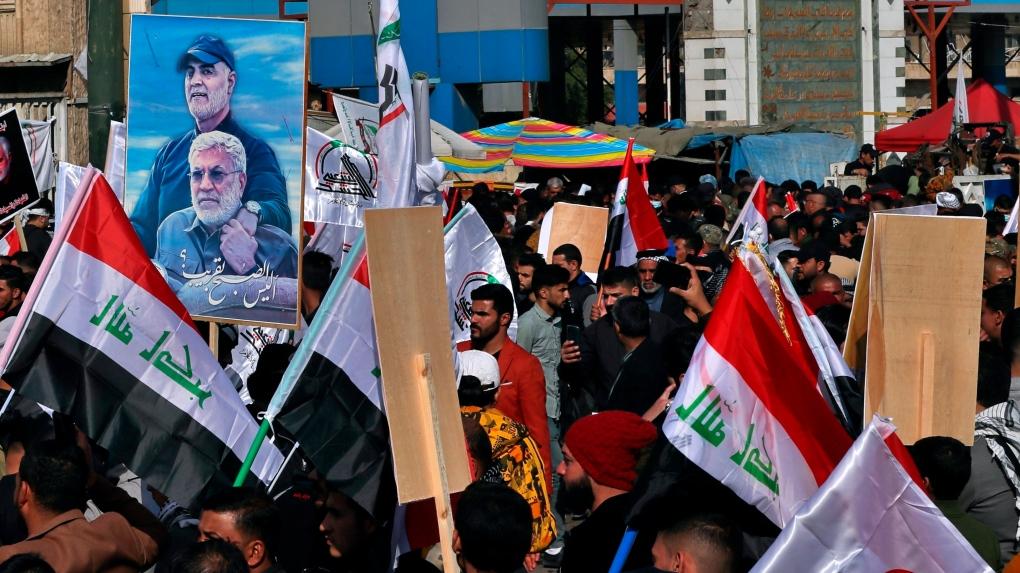 Iraqis chanting anti-U.S. slogans mark year since Soleimani killing