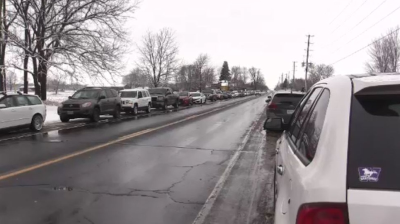 Cars filled of protestors park along John St. N in Aylmer, Ont. Sunday (Brent/Lale/CTV London)