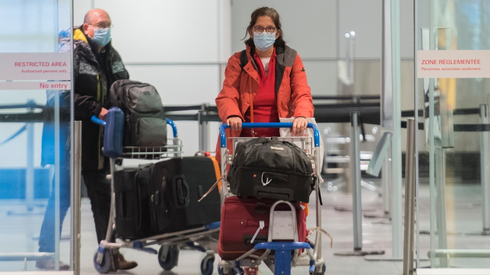 Passengers are shown in the international arrivals hall at Montreal-Trudeau Airport in Montreal, Tuesday, December 29, 2020, as the COVID-19 pandemic continues in Canada and around the world. THE CANADIAN PRESS/Graham Hughes