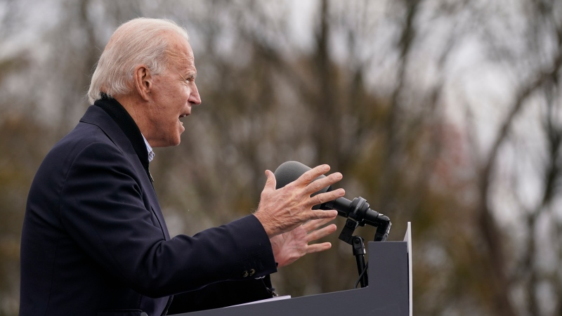 In this Dec. 15, 2020, file photo U.S. President-elect Joe Biden speaks at a drive-in rally for Georgia Democratic candidates for U.S. Senate Raphael Warnock and Jon Ossoff in Atlanta. (AP Photo/Patrick Semansky, File)