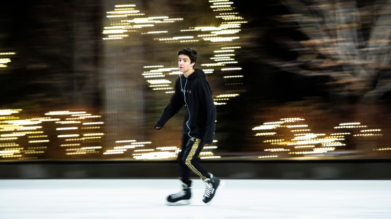 A skater skates in front of lights adorning the trees at the Lansdowne Skating Court in Ottawa, on Christmas Day, Friday, Dec. 25, 2020. The site was intended to be the venue for the Ottawa Christmas Market, which was cancelled due to the COVID-19 pandemic. (Justin Tang/THE CANADIAN PRESS)