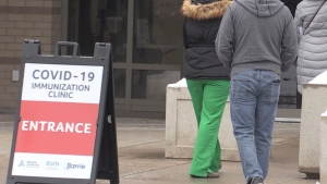 Frontline healthcare workers line up for a COVID-19 vaccine in Barrie, Ont.  (Siobhan Morris/CTV News)