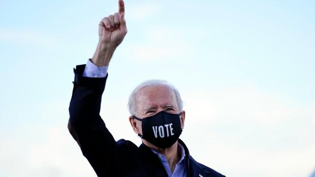 President-elect Joe Biden arrives to speak in Atlanta, Monday, Jan. 4, 2021, as he campaigns for Democratic Senate candidates Raphael Warnock and Jon Ossoff. (AP Photo/Carolyn Kaster)