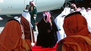 Saudi Crown Prince Mohammed bin Salman, centre right, greets the Emir of Qatar Sheikh Tamim bin Hamad Al Thani, as he arrives at Al Ula airport in Saudi Arabia, on Jan. 5, 2021. (Amr Nabil / AP)