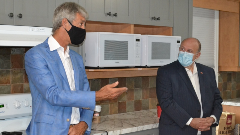 Michael Tibollo, associate minister of Mental Health and Addictions, right, tours Bluewater Health's Phase II Residential Management Site, with Bluewater Health President and CEO Mike Lapaine in Sept. 2020. (Source: Bluewater Health)