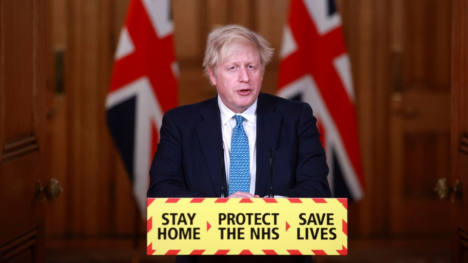 Britain's Prime Minister Boris Johnson speaks during a news conference in response to the ongoing situation with the coronavirus (COVID-19) pandemic, inside 10 Downing Street in London, Tuesday, Jan. 5, 2021. (Hannah McKay/Pool photo via AP)