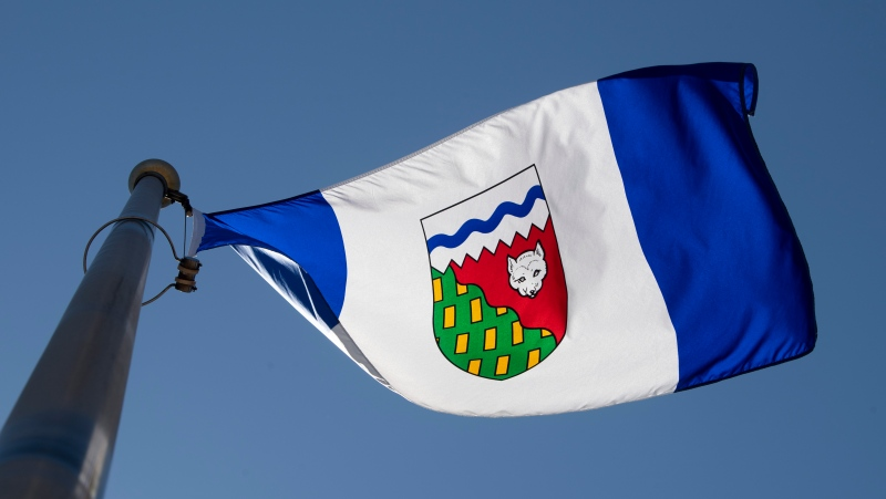 The Northwest Territories provincial flag flies on a flag pole in Ottawa, Monday July 6, 2020. People in the Northwest Territories who want to be organ donors can now do so through Alberta's registry. THE CANADIAN PRESS/Adrian Wyld