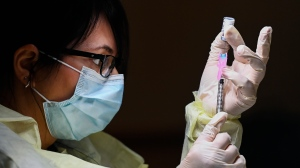 Francesca Paceri, a registered pharmacist technician carefully fills the Pfizer-BioNTech COVID-19 mRNA vaccine at a vaccine clinic during the COVID-19 pandemic in Toronto on Tuesday, December 15, 2020. Toronto and Peel region continue to be in lockdown. THE CANADIAN PRESS/Nathan Denette