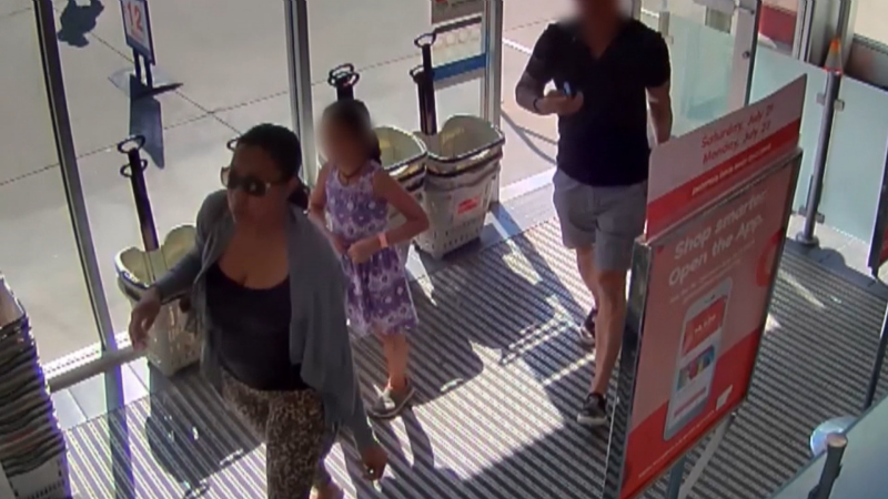 A woman identified by police as Kerry-Ann Lewis is seen in a Shoppers Drug Mart on the day the Langley, B.C. mother is accused of killing her seven-year-old daughter.