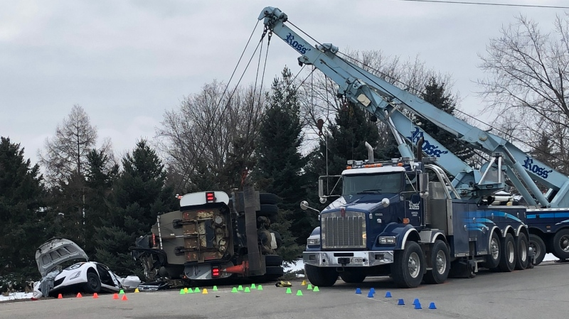 A truck had to be lifted off a car after a two-vehicle crash in southeast London, Ont. on Wednesday, Jan. 6, 2021. (Jim Knight / CTV News)