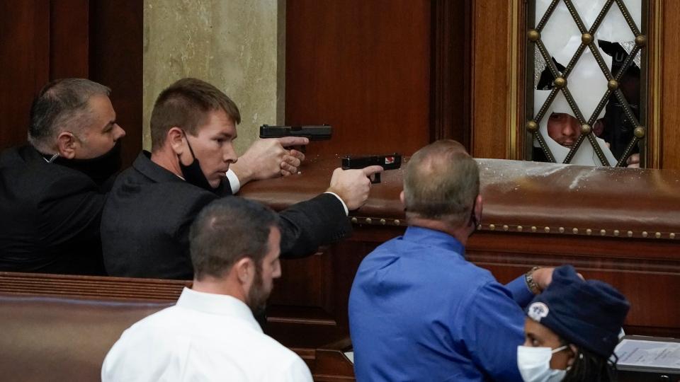 U.S. Capitol Police with guns drawn