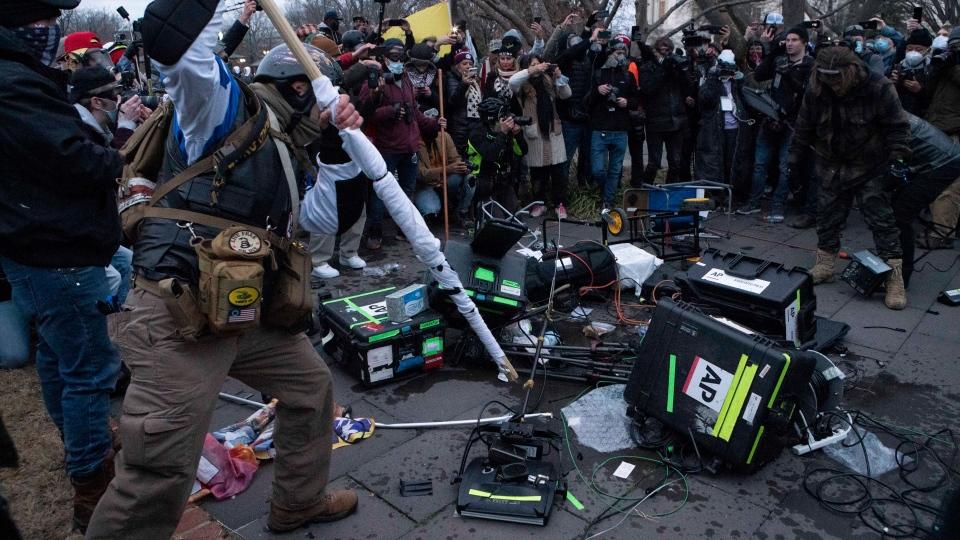 Rioters break TV equipment