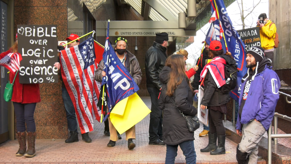 A group of Donald Trump supporters are seen outside the U.S. consulate in downtown Vancouver on Jan. 6, 2020. Afterwards, a mostly peaceful rally of about two dozen people turned violent when a man attacked a CBC News journalist.