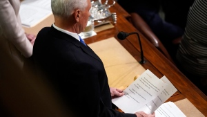 U.S. Vice-President Mike Pence announces the election of President and Vice President as he officiates a joint session of the House and Senate to confirm Electoral College votes at the Capitol, early Thursday, Jan 7, 2021, in Washington. (AP Photo/Andrew Harnik)