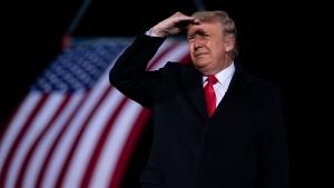 In this Monday, Jan. 4, 2021 file photo, U.S. President Donald Trump arrives to speak at a campaign rally for Sen. Kelly Loeffler, R-Ga., and David Perdue at Dalton Regional Airport, in Dalton, Ga. (AP Photo/Evan Vucci, File)