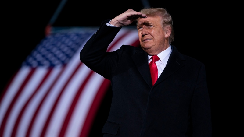In this Monday, Jan. 4, 2021 file photo, U.S. President Donald Trump arrives to speak at a campaign rally for Sen. Kelly Loeffler, R-Ga., and David Perdue at Dalton Regional Airport, in Dalton, Ga. (AP Photo/Evan Vucci, File)