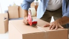 Person with a moving box is seen in this undated photo. (Shutterstock)