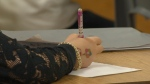 Student writing in school