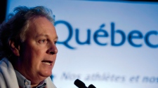 Quebec Premier Jean Charest speaks in Montreal, Sunday, Oct. 25, 2009. (Graham Hughes / THE CANADIAN PRESS)