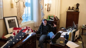 Richard Barnett, the man seen sitting at House Speaker Nancy Pelosi's desk during riots on Jan. 6, has been arrested and charged. (Saul Loeb/AFP/Getty Images)