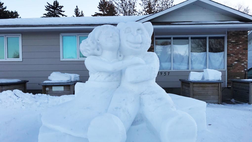 Hug snow sculpture Saskatoon
