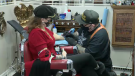 Tattoo shop owner Phil McLellan can be seen tattooing a customer on January 9. (Source: CTV News/Dan Timmerman)