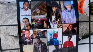 Photos of Jamal Francique are displayed at a vigil for the 28-year-old, who was fatally shot January 7, 2020. (CTV News/Natalie Johnson)