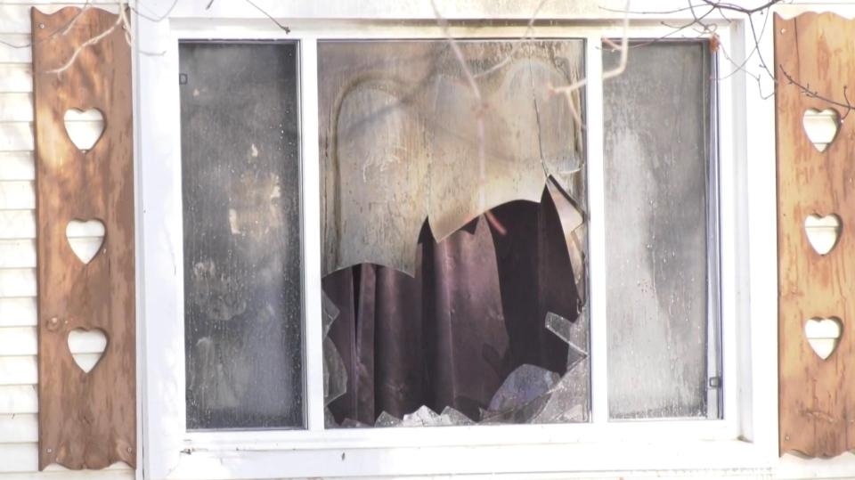 Broken window after Angus house fire