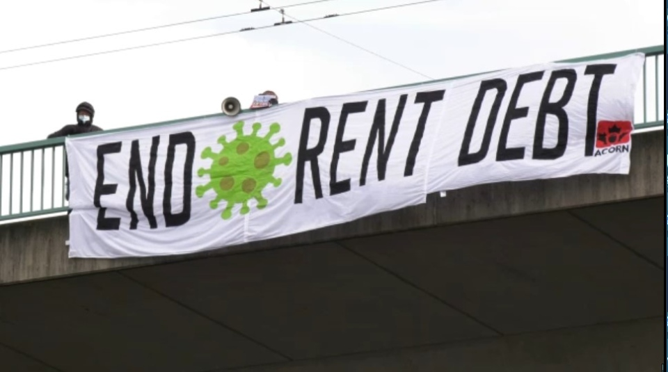 A banner drop on the Cambie Bridge in Vancouver on Jan. 9, 2021 that reads