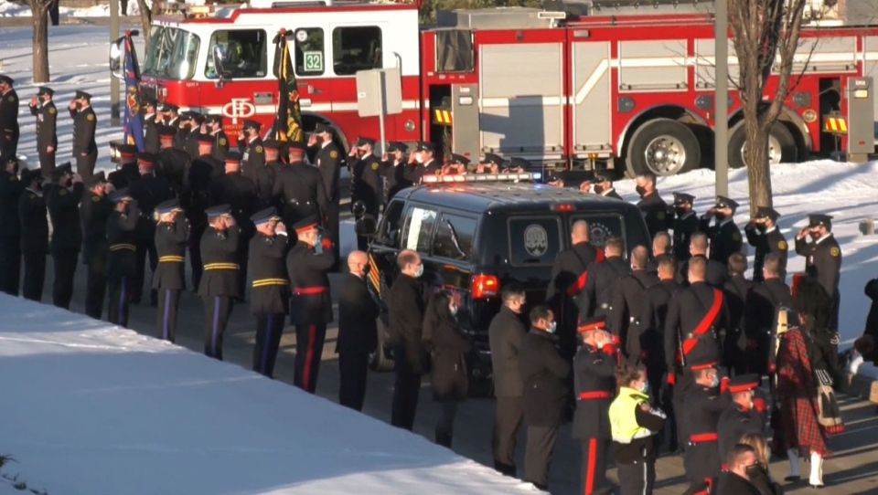 A private funeral for Sgt. Andrew Harnett was followed by a procession outside the Calgary Police Service headquarters on Jan. 9, 2021.