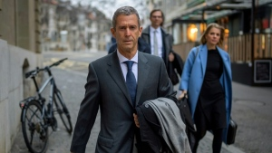 French-Israeli diamond magnate Beny Steinmetz walked to court for his corruption trial. (AFP)