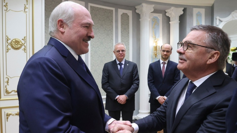 Belarusian President Alexander Lukashenko, left, greets International Ice Hockey Federation President Rene Fasel in Minsk, Belarus, on Jan. 11, 2021. (Nikolai Petrov / BelTA Pool Photo via AP)