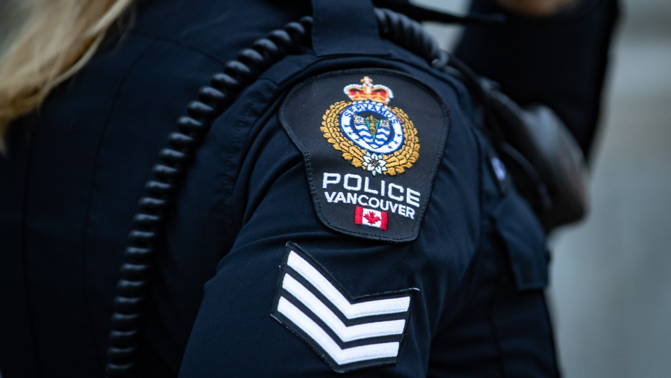 A Vancouver Police Department patch is seen on an officer's uniform as she makes a phone call after responding to an unknown incident in the Downtown Eastside of Vancouver, on Saturday, January 9, 2021. THE CANADIAN PRESS/Darryl Dyck