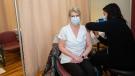 Public health nurse Tracy Nash, right, administers a COVID-19 vaccine to nurse Irenee Campbell at the Cape Breton Regional Hospital in Sydney on Jan. 11, 2021. (Photo: Communications Nova Scotia)