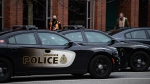 Police cars are seen parked outside Vancouver Police Department headquarters in Vancouver, on Saturday, Jan. 9, 2021. (Darryl Dyck / THE CANADIAN PRESS)